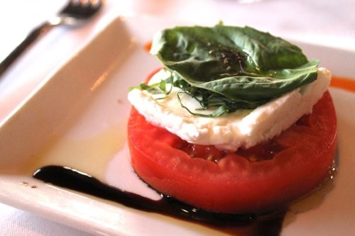 Insalata Caprese with tomato and mozzarella cheese with basil