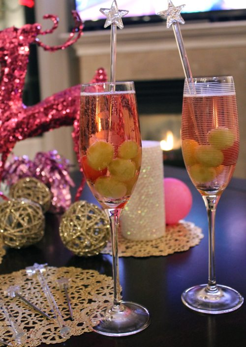 Frozen-grapes-and-champagne-by-the-fire-with-silver-stirrers