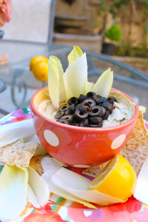 Healthy Christmas appetizers with black olives and Meyer lemons
