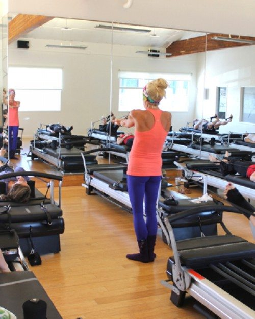 Lauryn Evarts, fitness and wellness blogger talks with Kim Kelly of Sculpt Pilates in Solana Beach.