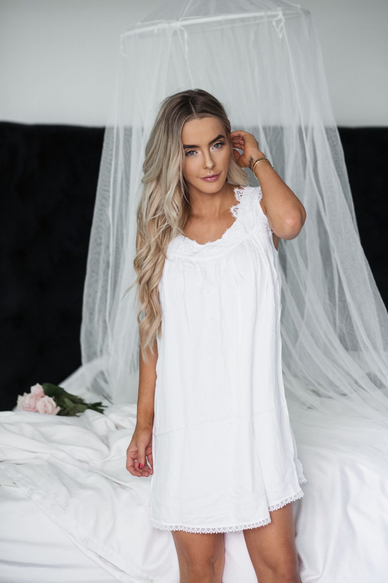 white dress night time look by the skinny confidential