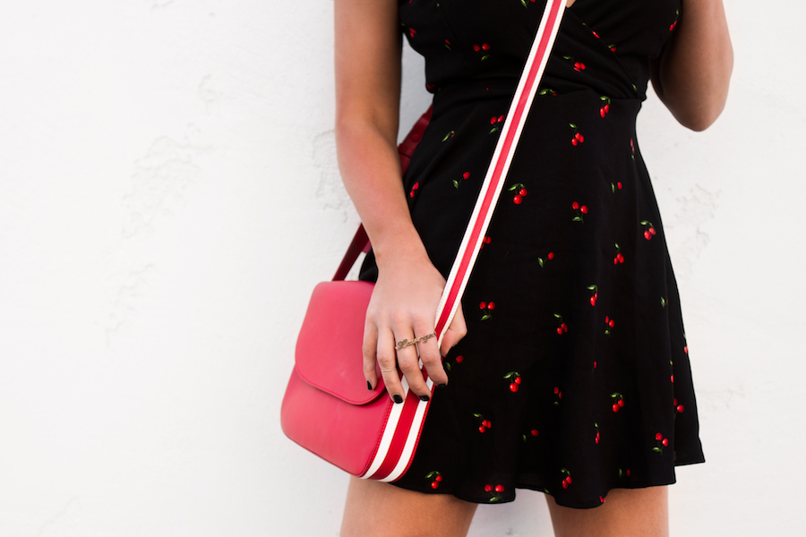 lulus flirty cherry mini dress red purse by the skinny confidential
